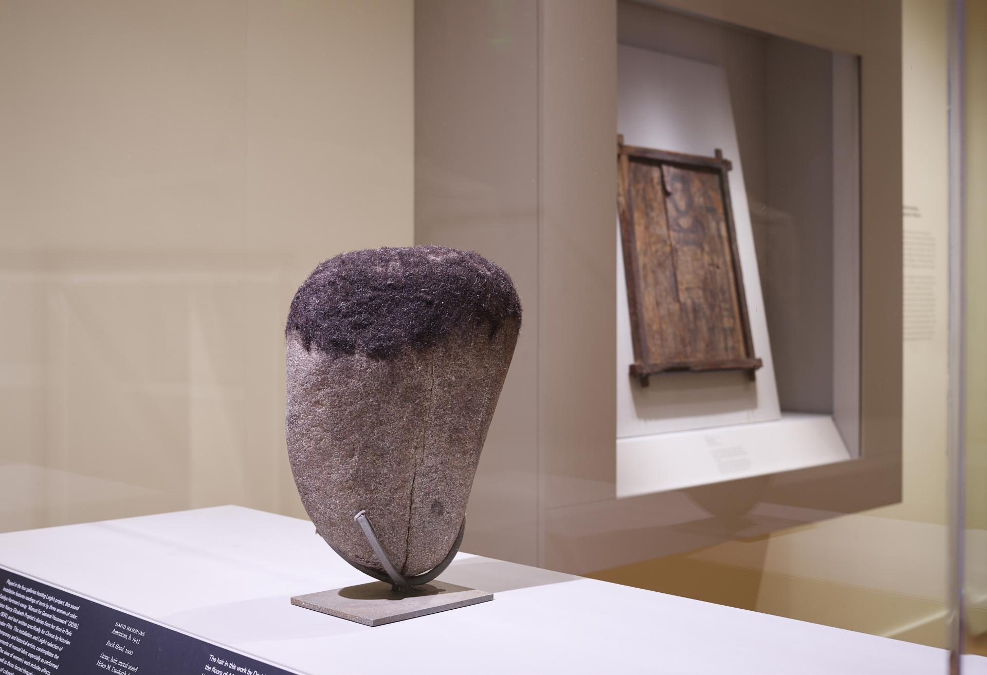 "Installation shot of David Hammons ""Rock Head"" sculpture on view in the Egyptian gallery"