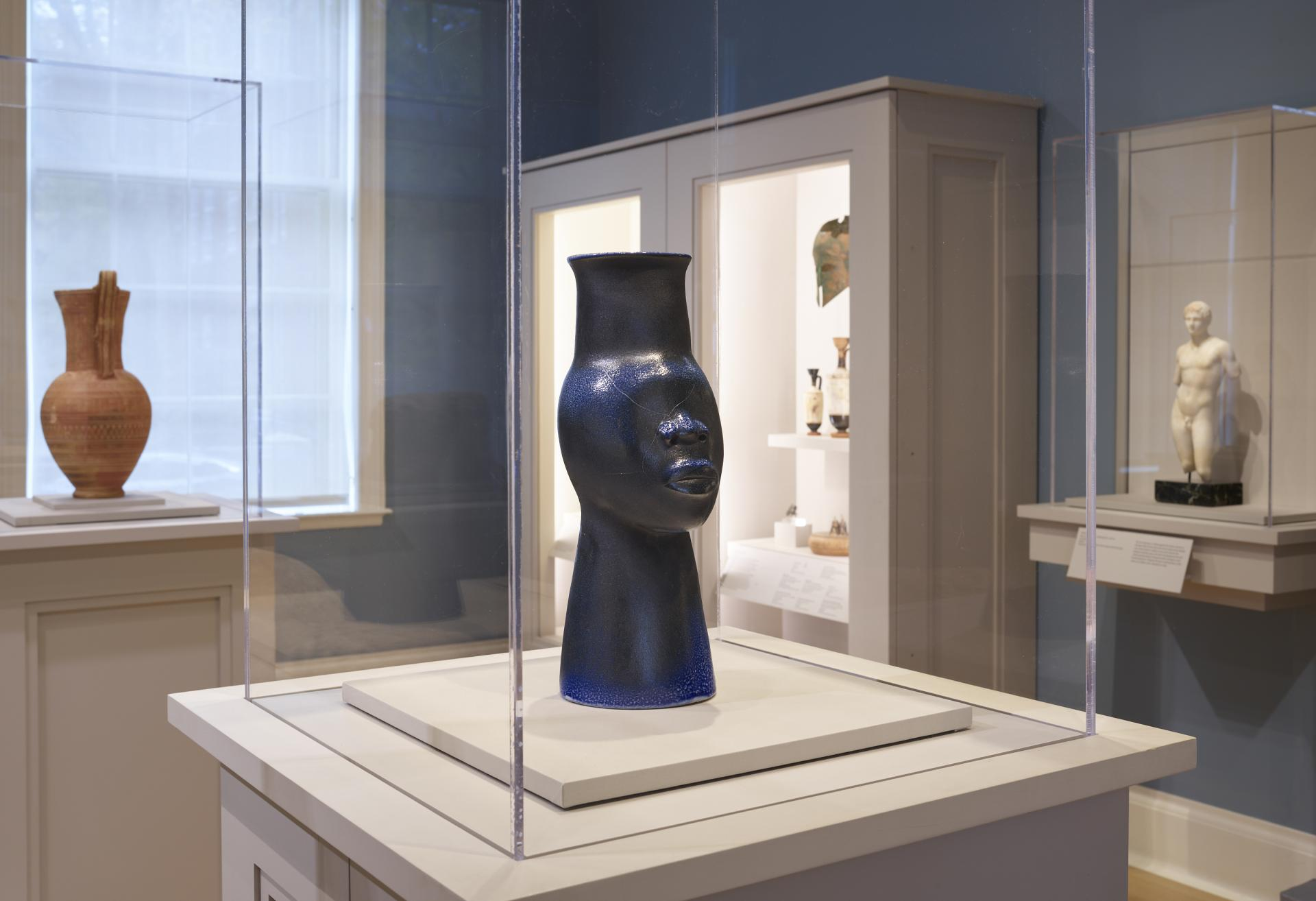 "Installation shot of Simone Leigh ""108 (Face Jug Series)"" sculpture on view in the Greek and Roman gallery"
