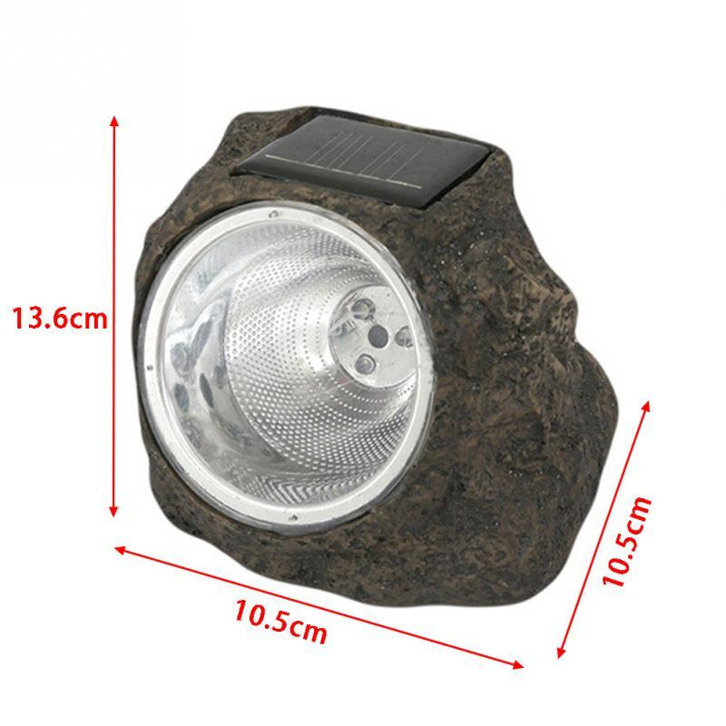 solar-powered LED light made to look like a rock