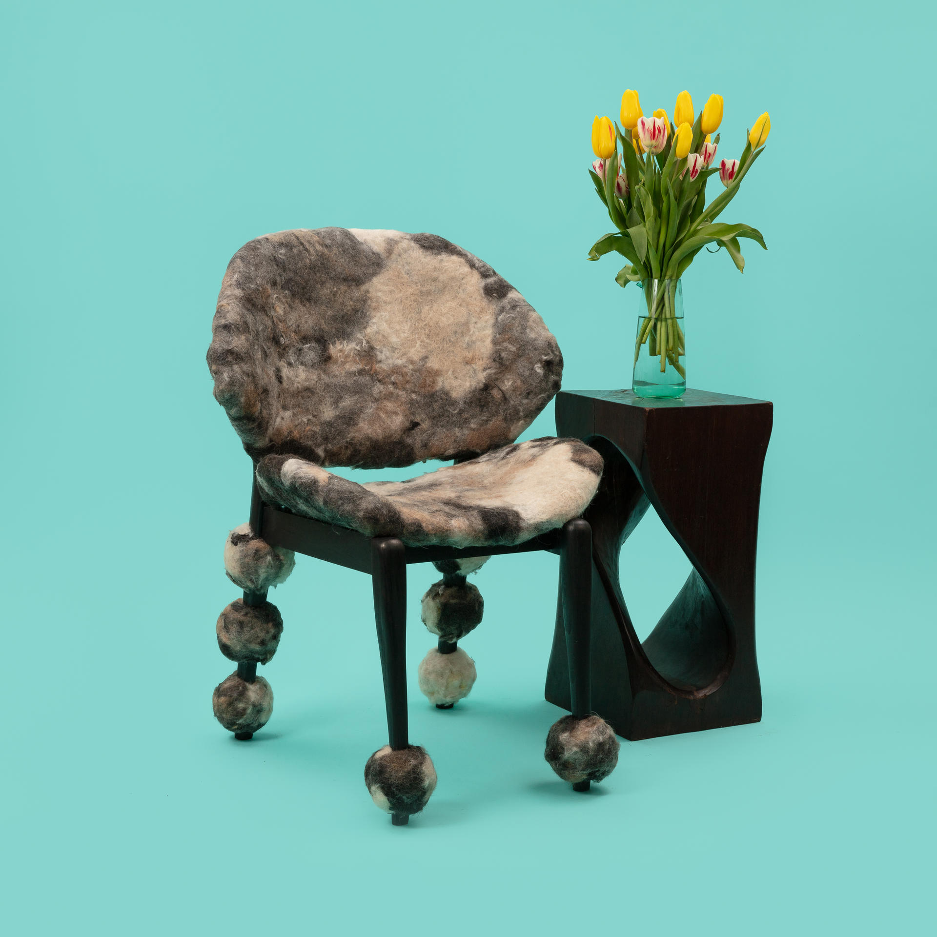 Wooden chair upholstered with handmade felt made from dog hair.