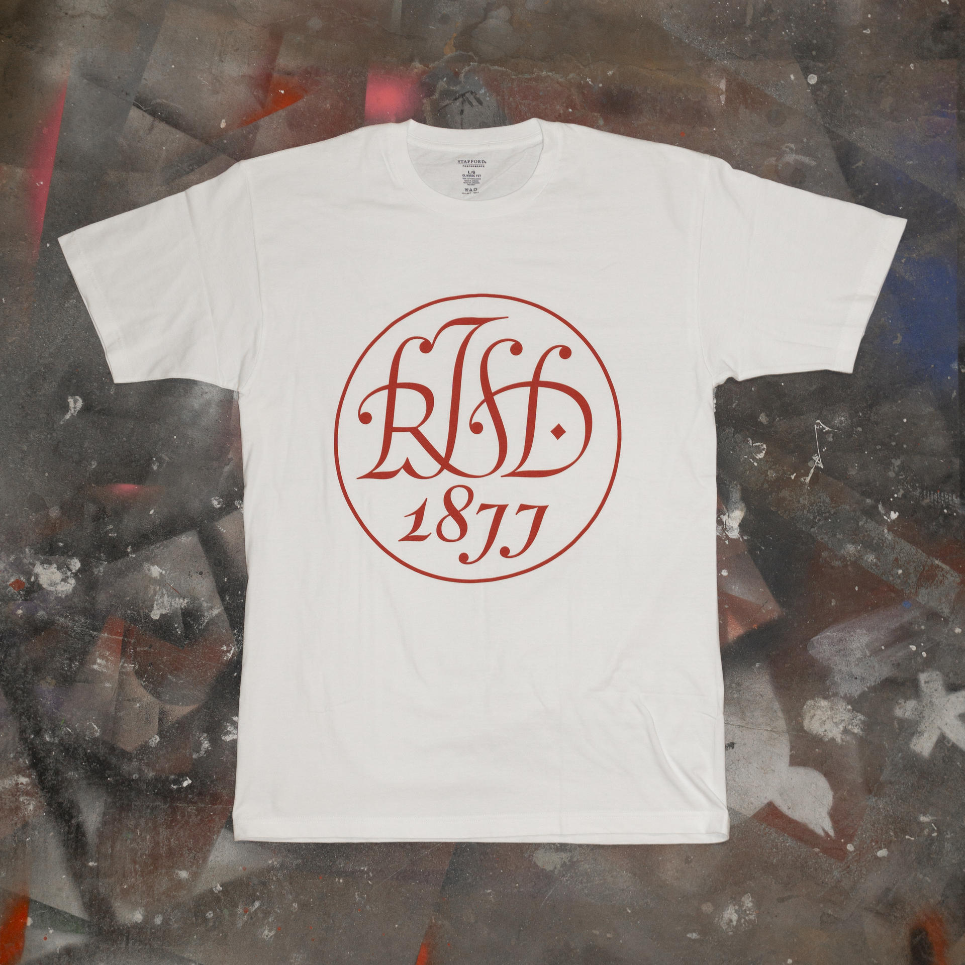 "T-shirt design with a holiday version of the original ""RISD 1877"" seal designed by John Howard Benson"