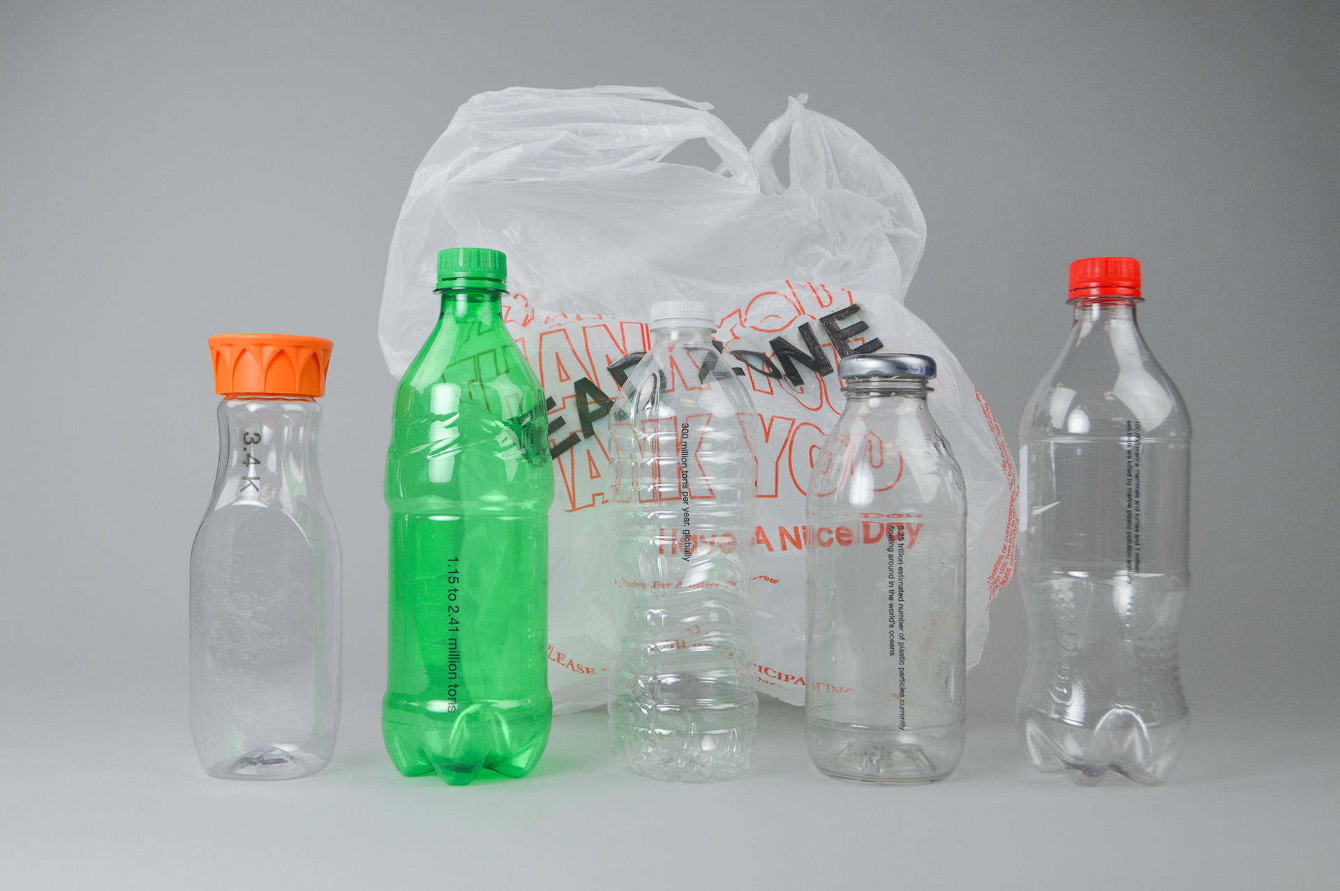Five plastic bottles with a plastic bag behind them with the text 'Dead Zone' printed on it