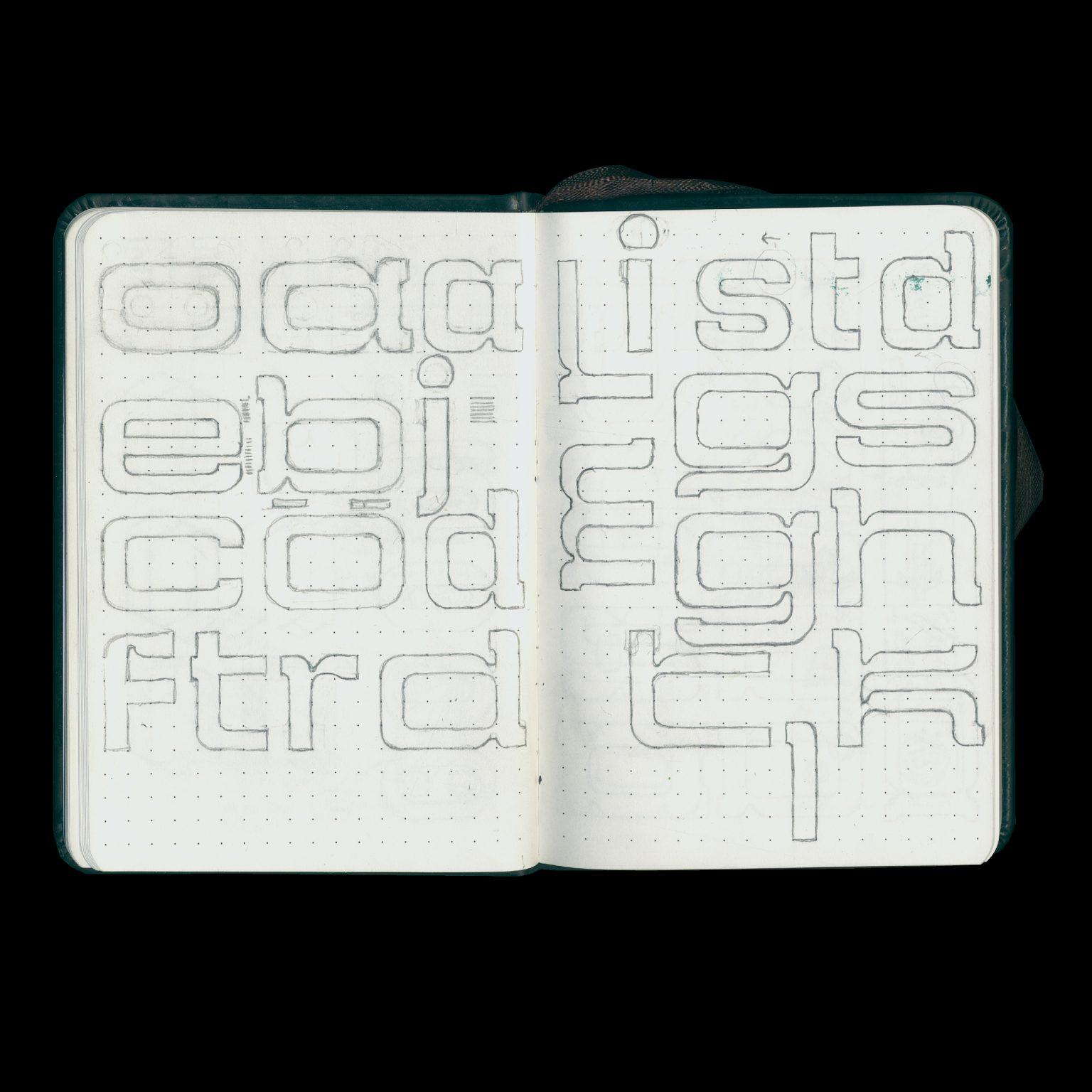 Open sketchbook with sketches of the typeface 'Junction'